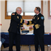 Assistant Chief Steve Skulski, left, is congratulated by Chief Jeff Berino