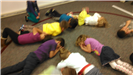 Children practicing stop, drop and roll