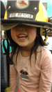Young girl wearing Fire Rescue helmet