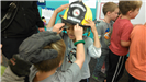 Boys trying on Lake Dillon Fire Rescue helmet