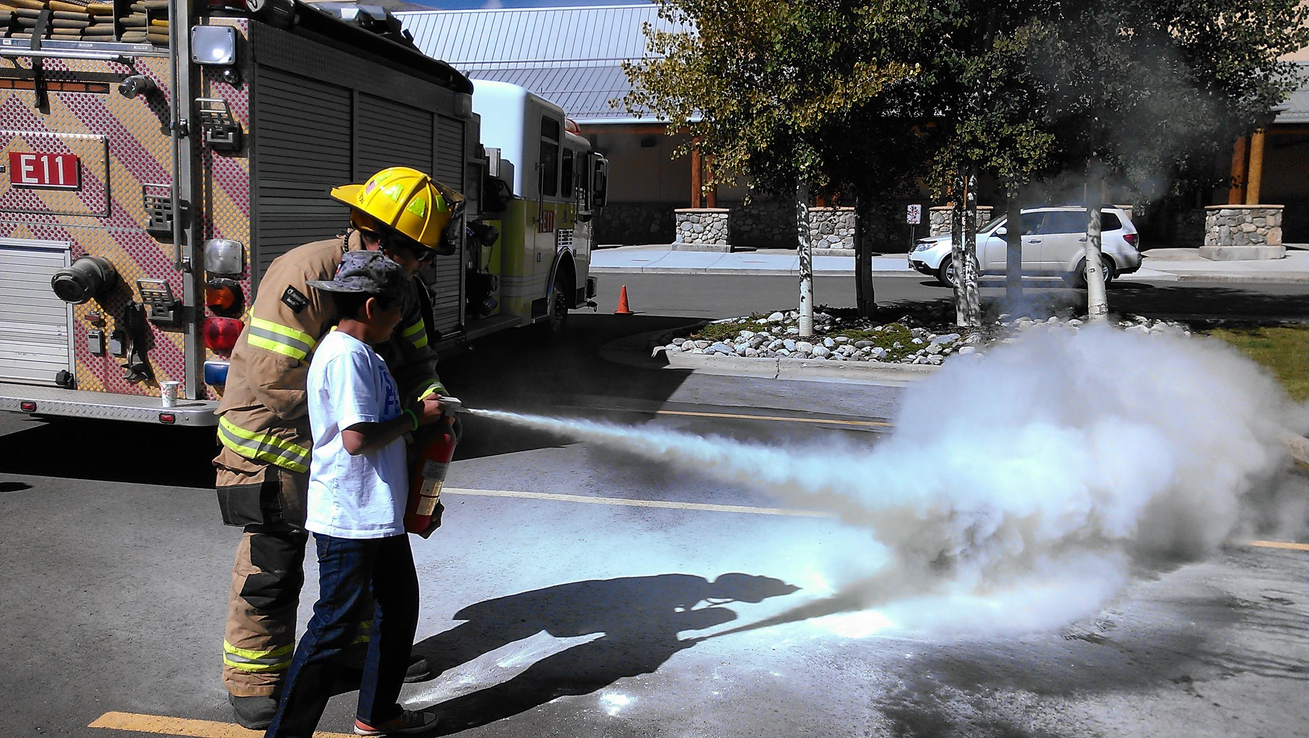 Firefighter Andrew Segura teaches the proper use of a fire extinguisher