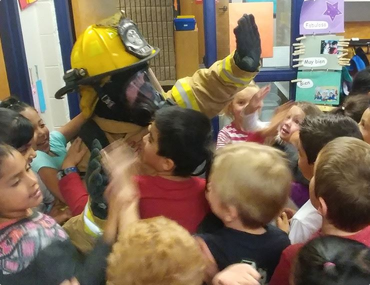 firefighter with children