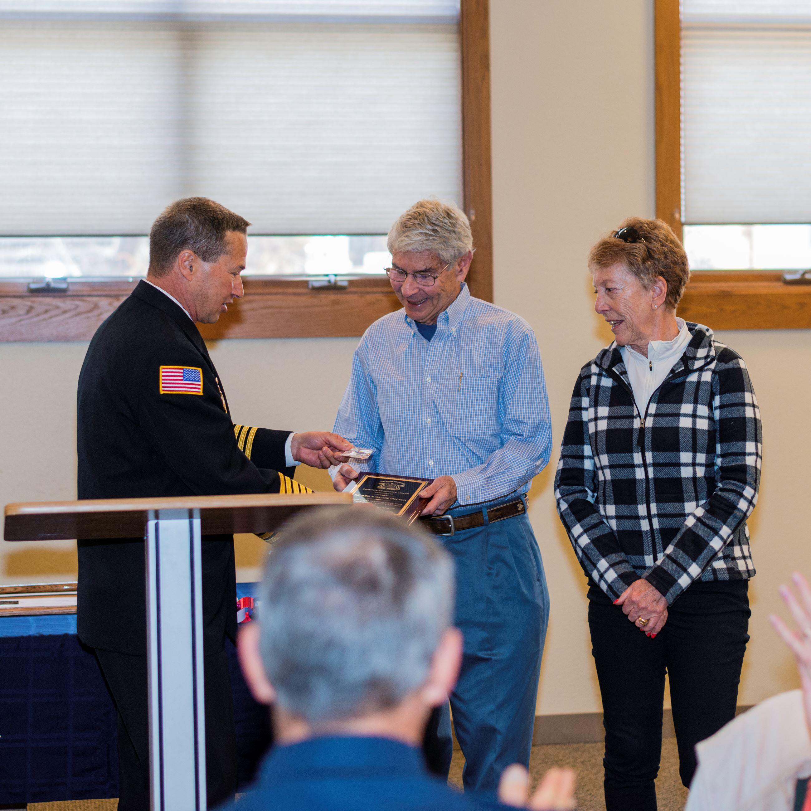 Dr. John and Maggie Hillman receive a Citizens Award from Chief Jeff Berino