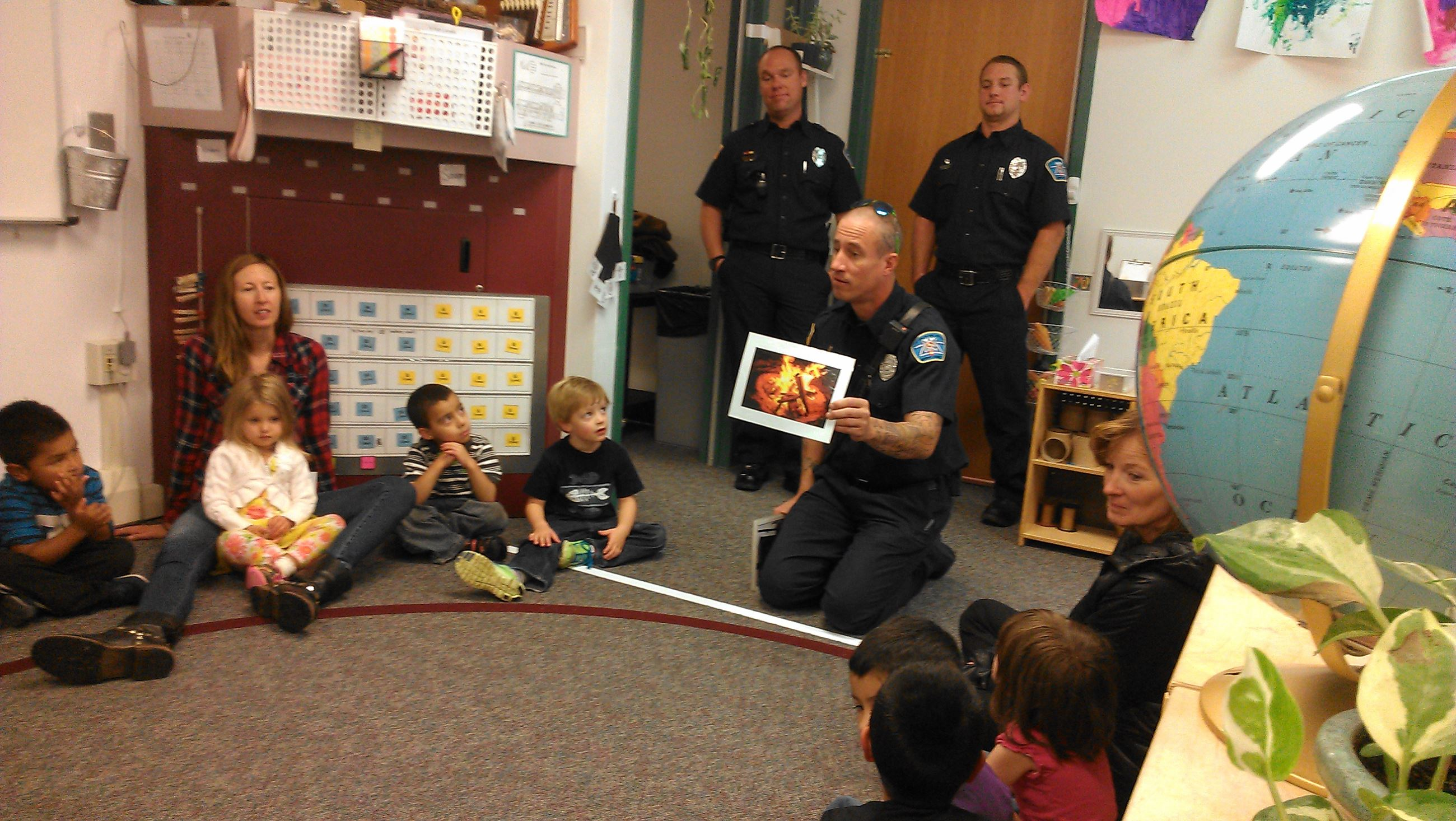 Firefighter-medic Jon Hannum talks with pre-school kids about good fire and bad fire